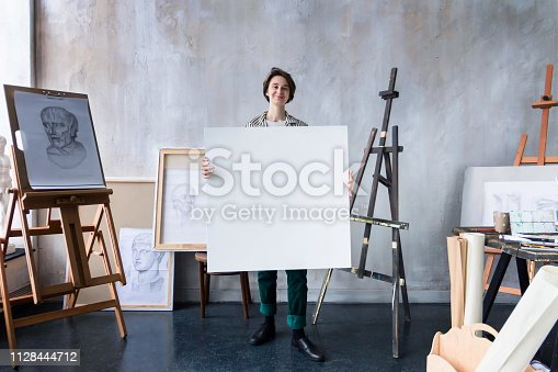 istock Young successful artist in art workshop studio 1128444712