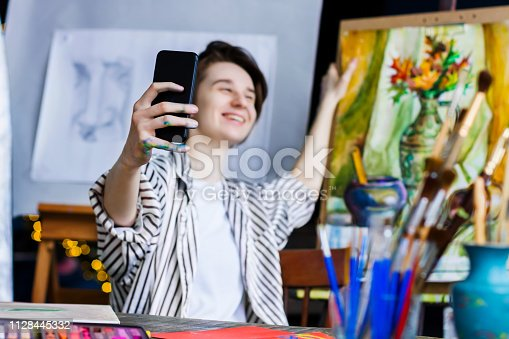 istock Young successful artist in art workshop studio 1128445332
