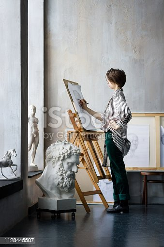 517780131 istock photo Young successful artist in art workshop studio 1128445507