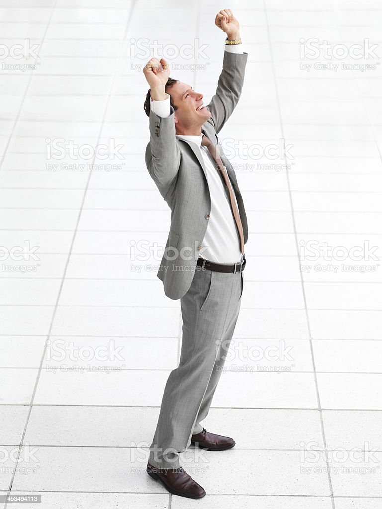 Young successful happy business man celebrating success royalty-free stock photo