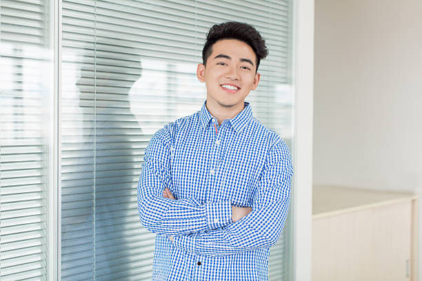 young successful man chinese young and handsome young man, wearing a blue shirt civil servant stock pictures, royalty-free photos & images