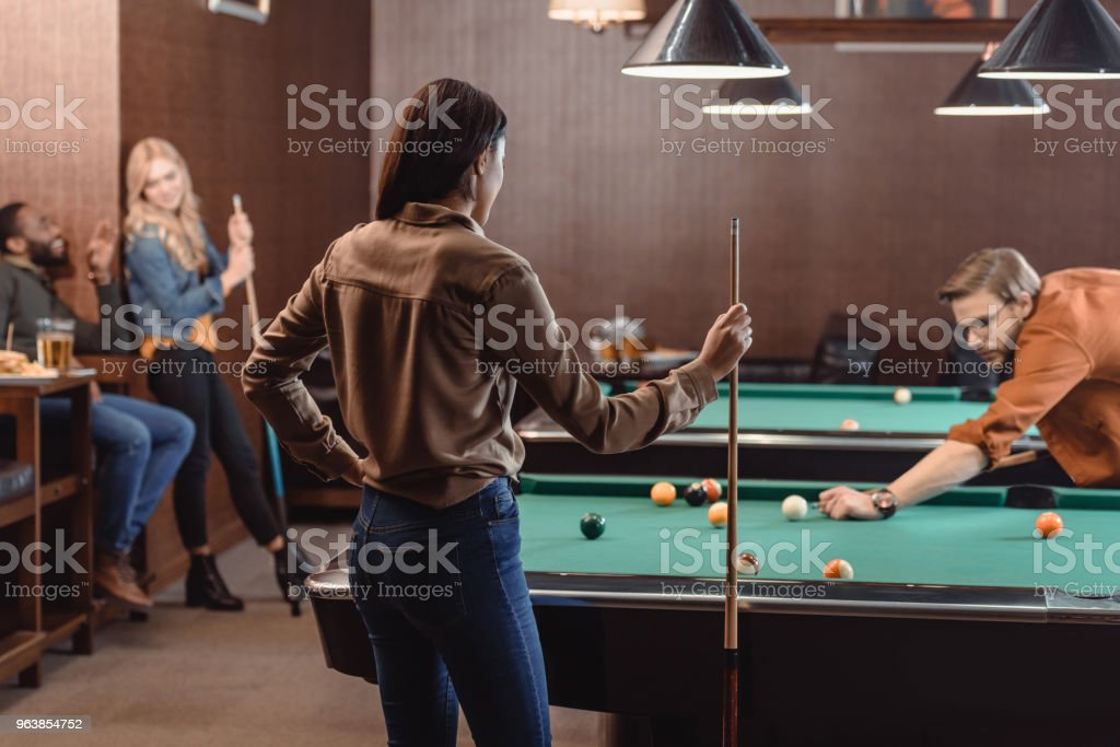 young successful multiethnic friends playing in pool at bar - Royalty-free Adult Stock Photo