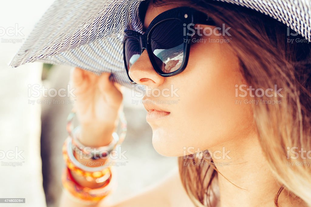 young summer girl wearing  hat  and sunglasses stock photo