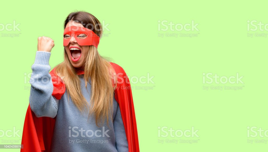 Young super woman irritated and angry expressing negative emotion,...