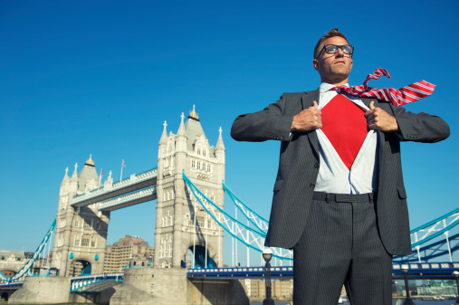 Young Superhero Businessman Reveals Red Chest at London Skyline
