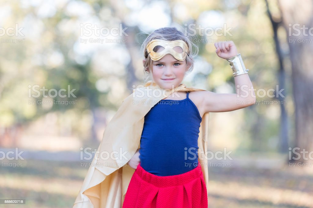 Young superhero saves the day stock photo