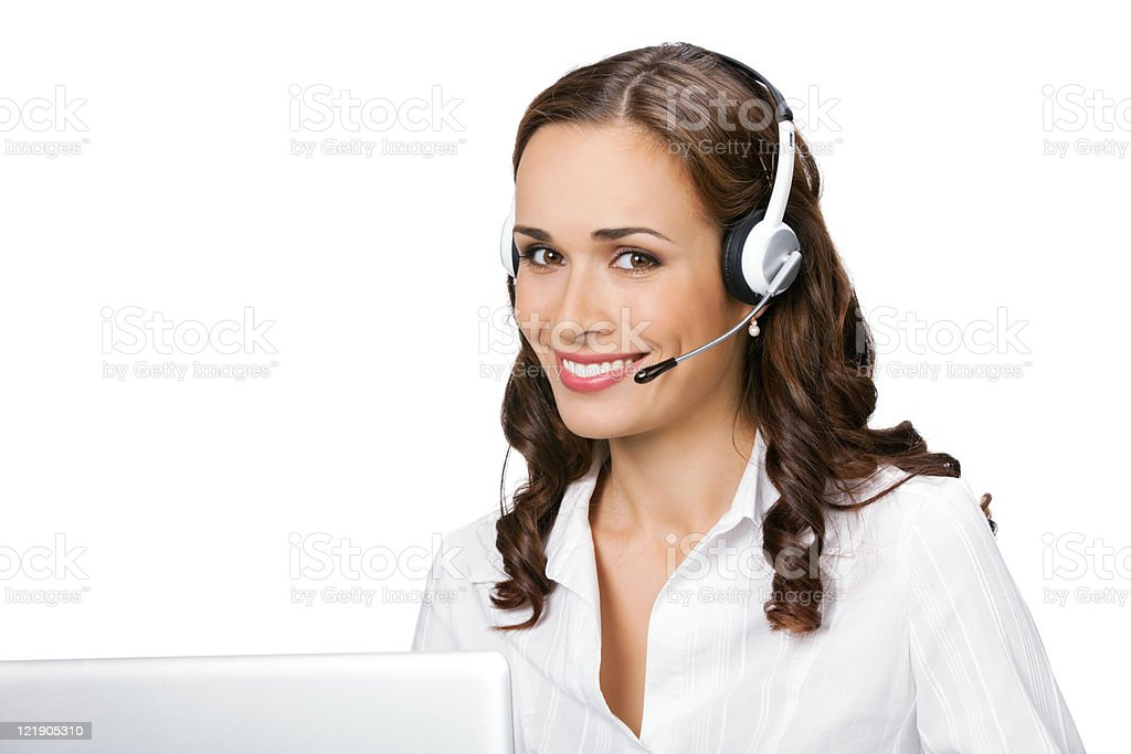 Young support phone operator in headset with laptop, isolated stock photo