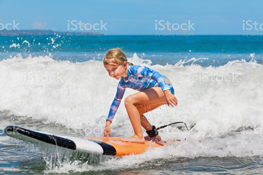 5198359f17 Young Surfer Rides On Surfboard With Fun On Sea Waves Stock Photo ...