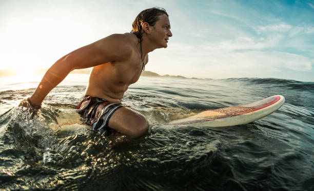 Young surfer with board stock photo