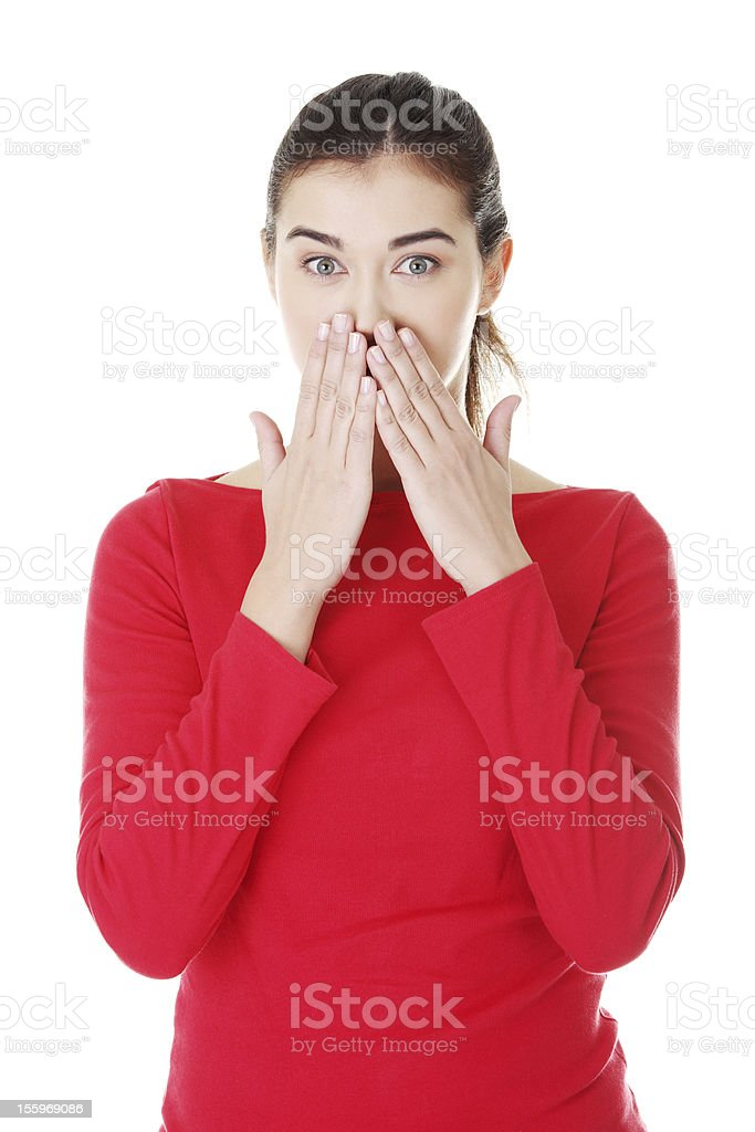 Young surprised woman covering her mouth royalty-free stock photo