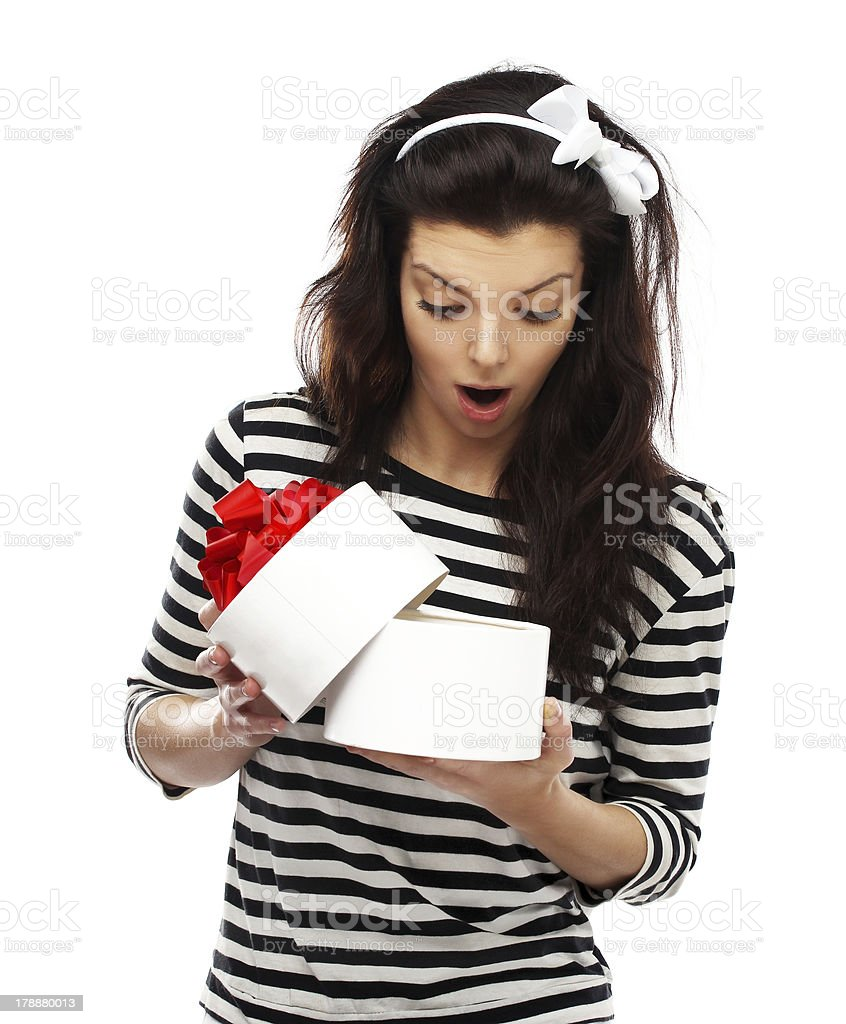 Young surprised woman holding Gift Box royalty-free stock photo