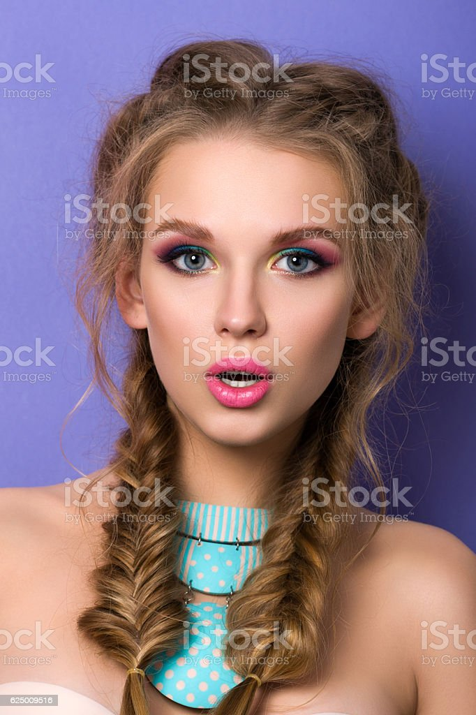 Young surprised woman with bright candy colors make-up stock photo
