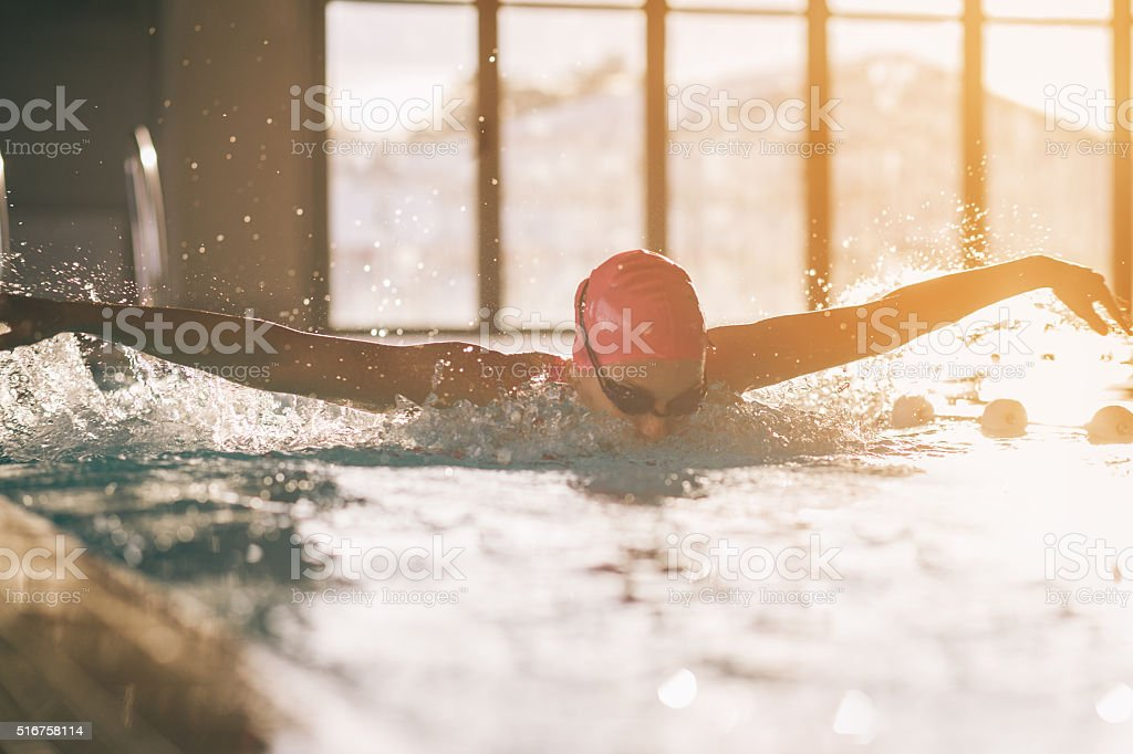 Young swimmer girl swimming butterfly stock photo