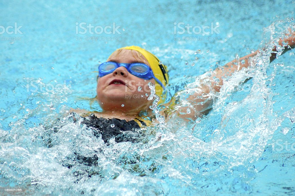 Young Swimmer Swims Backstroke stock photo