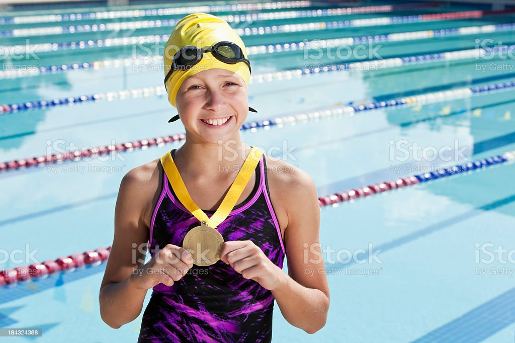 Young swimmer with a medal stock photo