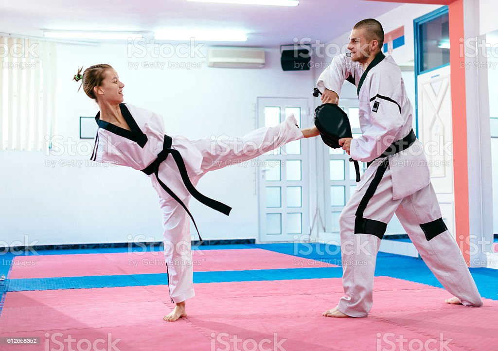 Young taekwondo girl with no upper limbs stock photo