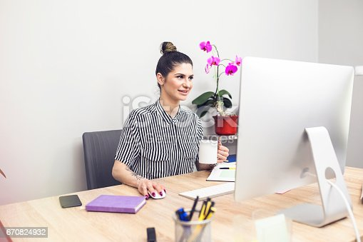 518704237 istock photo Young tattoo business woman in office 670824932