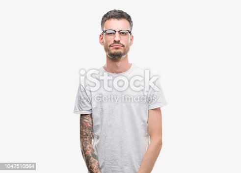 Young tattooed adult man depressed and worry for distress, crying angry and afraid. Sad expression.