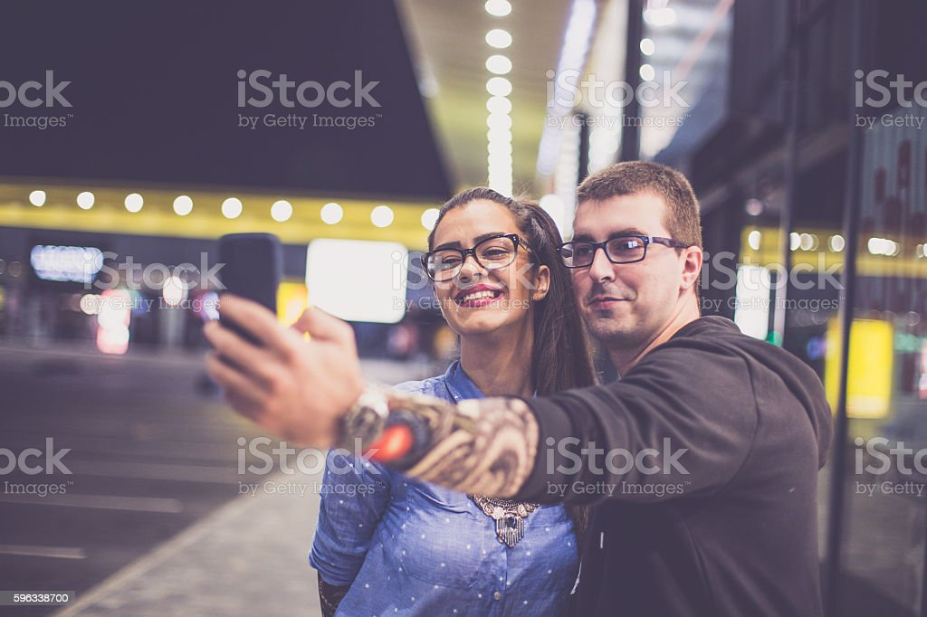 Young Tattooed Couple Making Selfie royalty-free stock photo