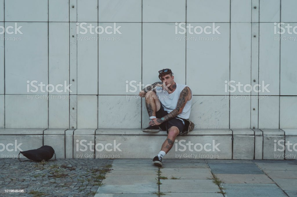 Young tattooed man on the street Young tattooed man on the street. 20-24 Years Stock Photo