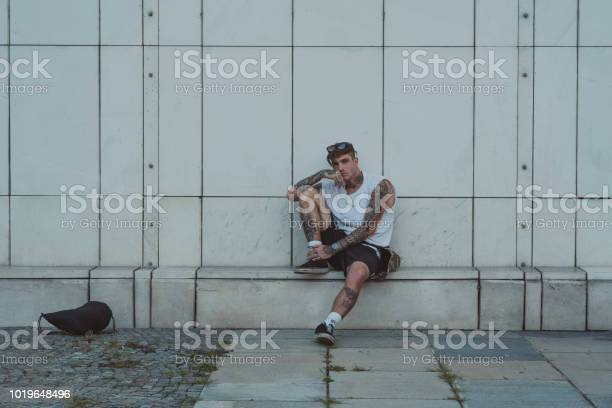 Young Tattooed Man On The Street Stock Photo - Download Image Now