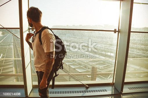 Young tattooed man traveller