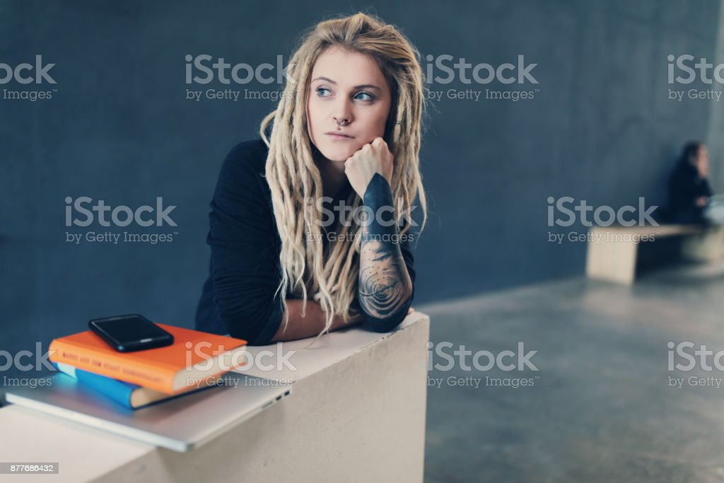 Young tattooed woman in the university stock photo