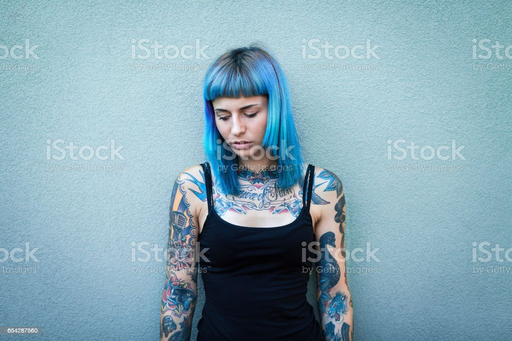 Young tattooed women with blue hair stock photo