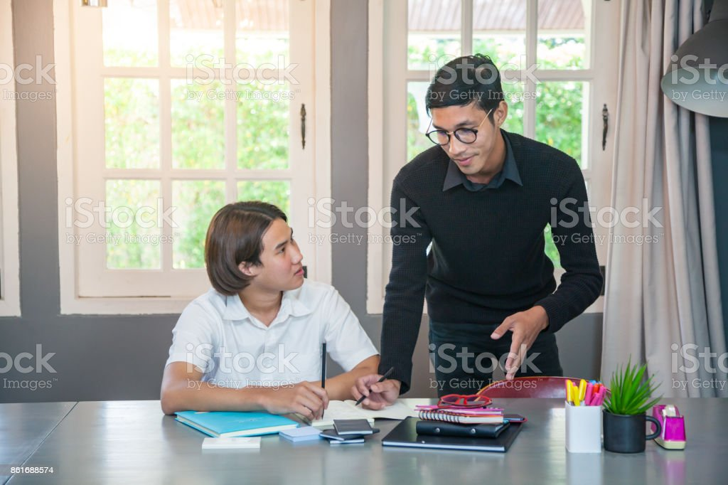 Young teacher and student stock photo