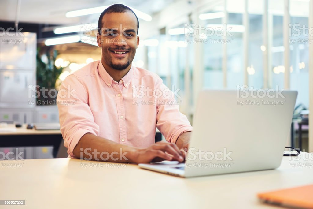 Young teacher and student product and service overview working in coworking place using 5G wireless stock photo