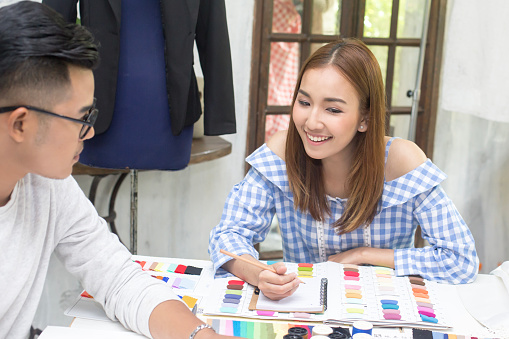 Young Team Asian Designer Warking At Studio Fashion Designer Carefully Creating New Fashionable Styles Dressmaker Makes Clothes Via Additional Parttime Job Stock Photo Download Image Now Istock