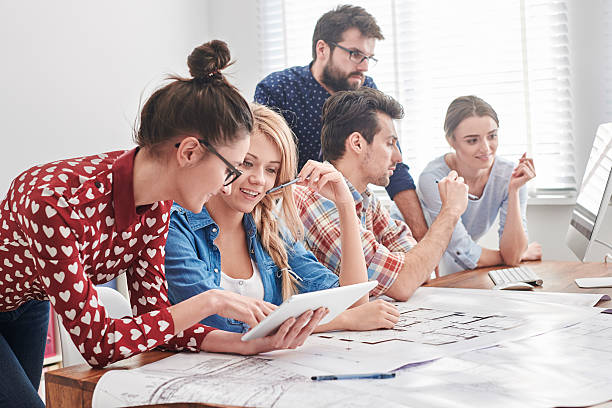 Young team of architects working on a new project stock photo