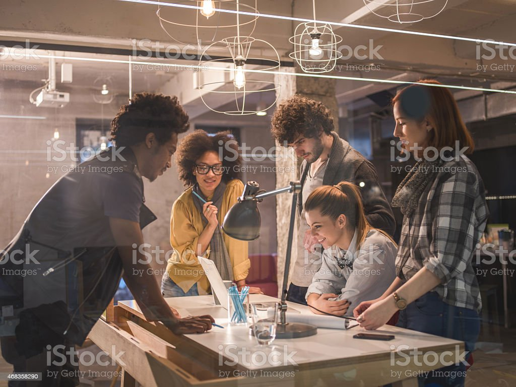 Young team of designers working in office and using computer. royalty-free stock photo