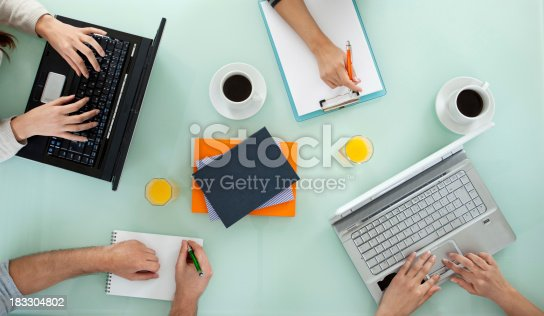 istock Young team working on laptop computers and writing 183304802