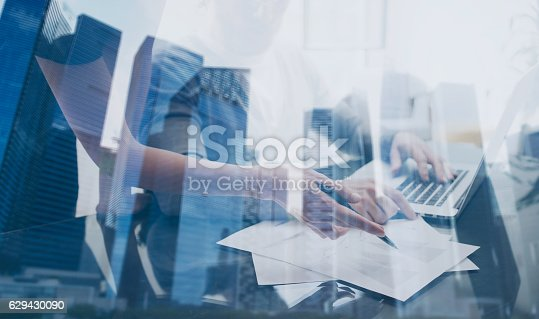 629421870 istock photo Young team working together with modern laptop in coworking place 629430090