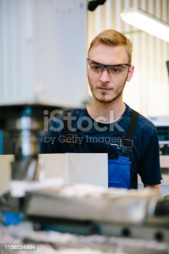 istock young technician works at a milling machine 1156534994
