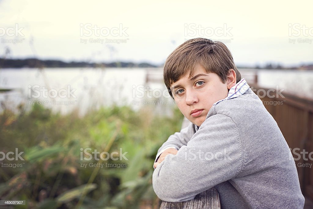 Young Teen Boy Posing on Pier Outdoors - Stock image .