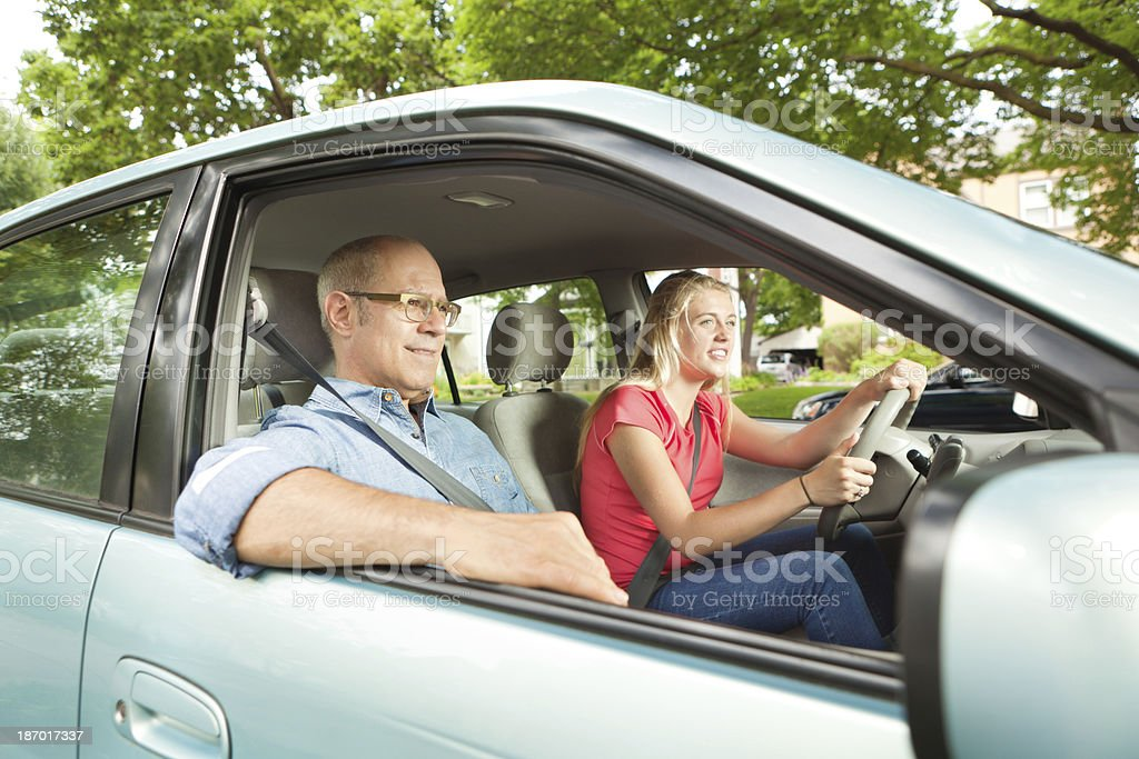 Young Teen Driver Driving with Parent royalty-free stock photo