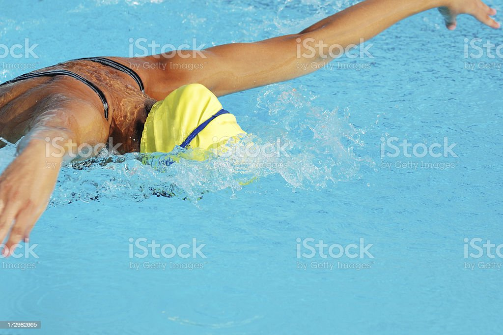 Young Teen Female Butterfly Stroke Swimmer stock photo