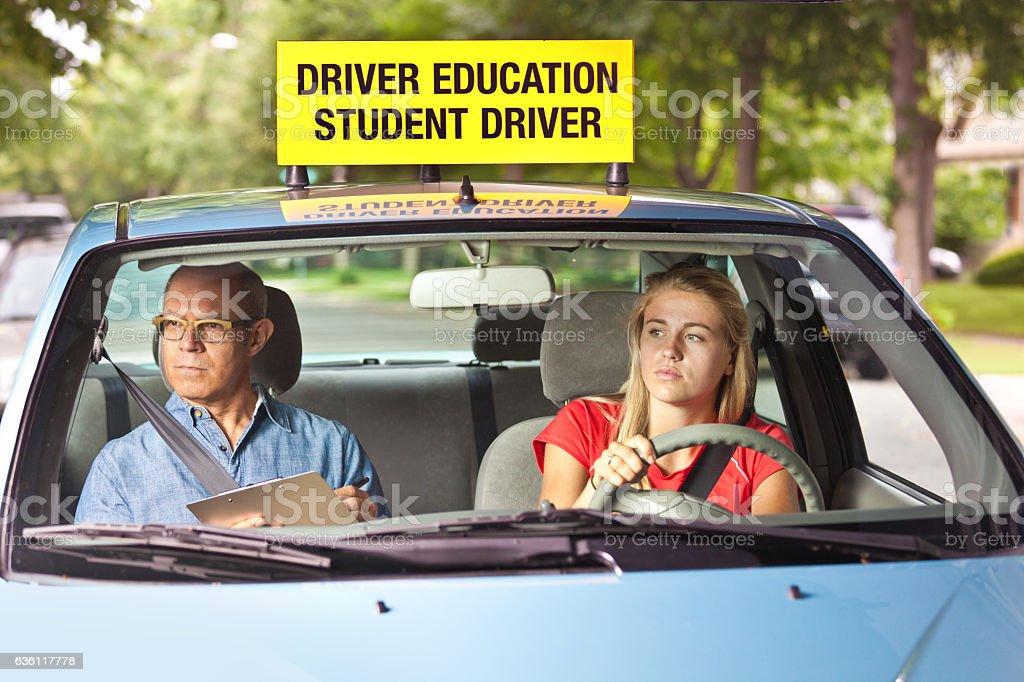 Young Teen Girl Doing Driving Exam with Examiner - foto de stock