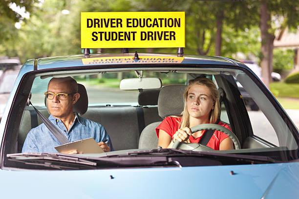 young teen girl doing driving exam with examiner - autos für fahranfänger stock-fotos und bilder