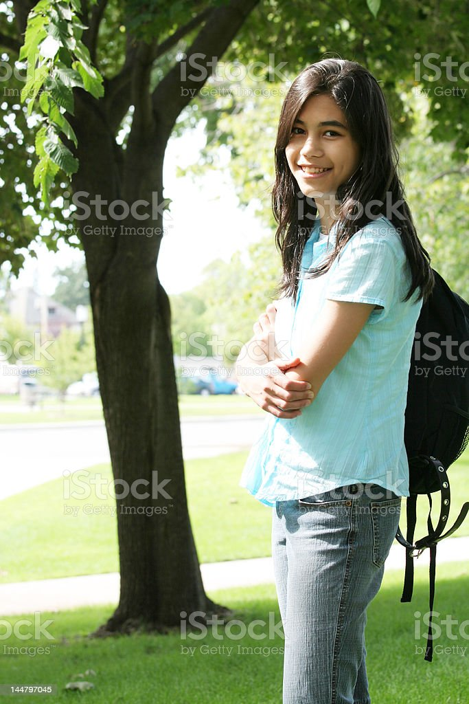 Young teen girl ready for school with backpack royalty-free stock photo