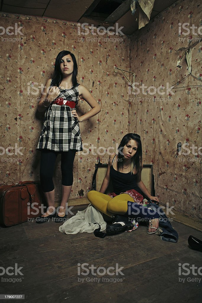 Young Teen Girls with Clothes in Trashed House royalty-free stock photo