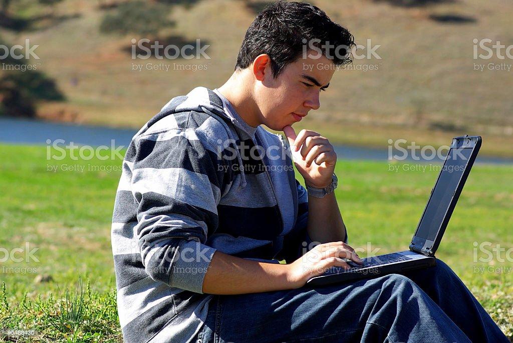 Young teen laptop man royalty-free stock photo