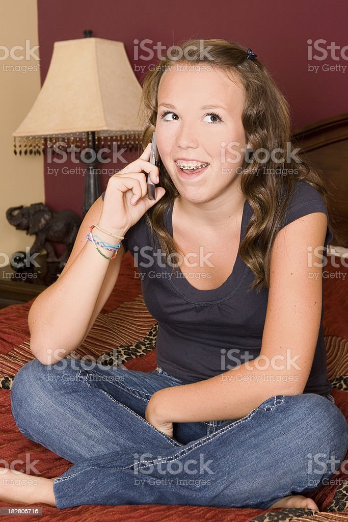 Young teen talking on cell phone royalty-free stock photo