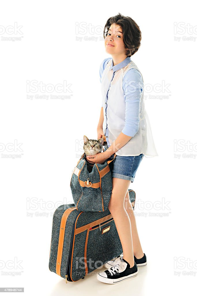 Young Teen Traveling with Kitty stock photo