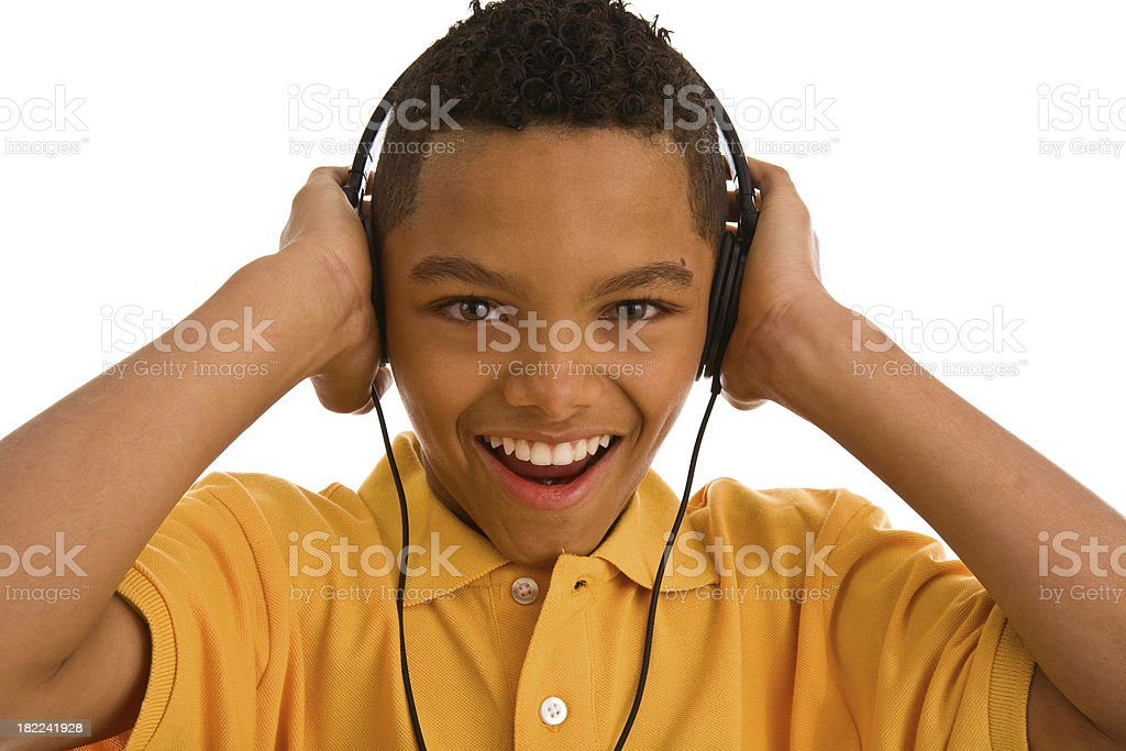 Young teenage boy wearing headphone and smiling royalty-free stock photo