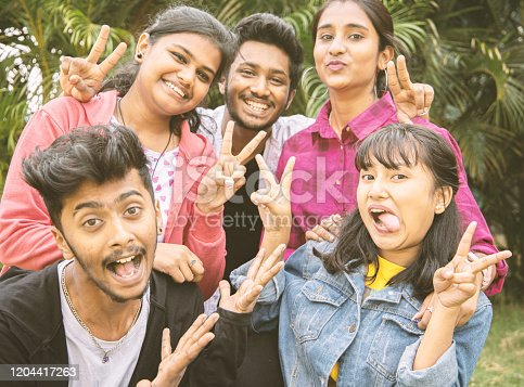 861023492 istock photo Young teenage friends taking selfie with funny faces - Concept of youth happy friendship having fun together - Millennials of selfie generation. 1204417263