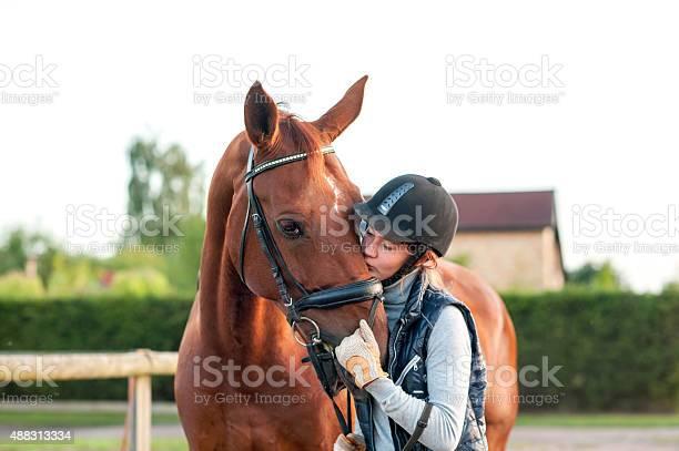Young teenage girl equestrian kissing her chestnut horse picture id488313334?b=1&k=6&m=488313334&s=612x612&h=r10flpd 7rw6ax9v bwrlkt8q3igpkilpioqqrmcqhu=