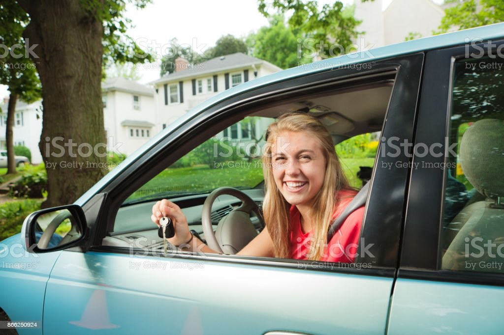 Young Teenage Girl Student Driver with Her New Car stock photo